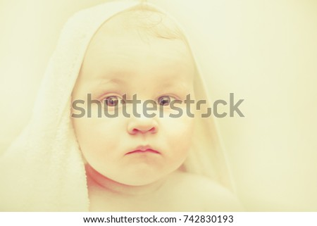 Baby boy portrait photo. Jesus baby picture for Merry Christmas. Fatty toddler with white towel on head after bath or shower.  Kid in sauna and bathing