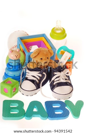 baby boy`s shoes with pregnancy ,teddy bear ,toys ,stuffs and letters b,a,b,y isolated on white