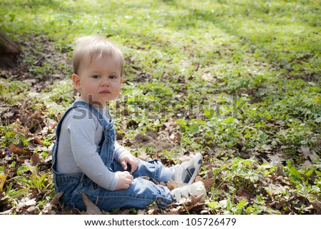 Baby boy sitting on grass outdoor