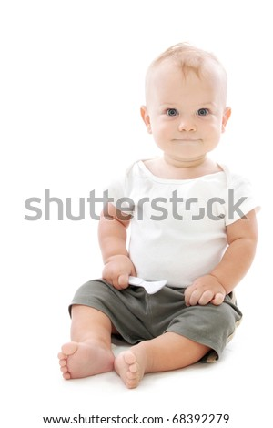 Baby Boy smiling, sitting with a spoon