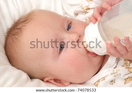 Baby boy sucking on his bottle