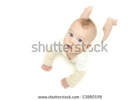 Baby boy, tummy time, looking up, on white background