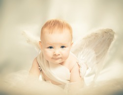 baby boy with angel wings