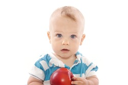 Baby boy with apple on white background
