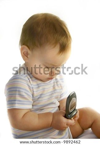 baby boy with cell phone over white