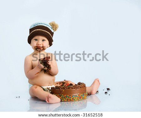 baby boy with hat and cake - stock photo