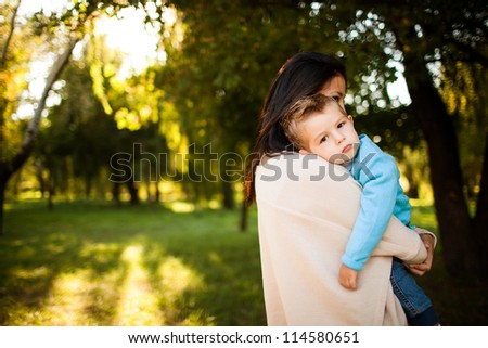 baby boy with his mum in the park
