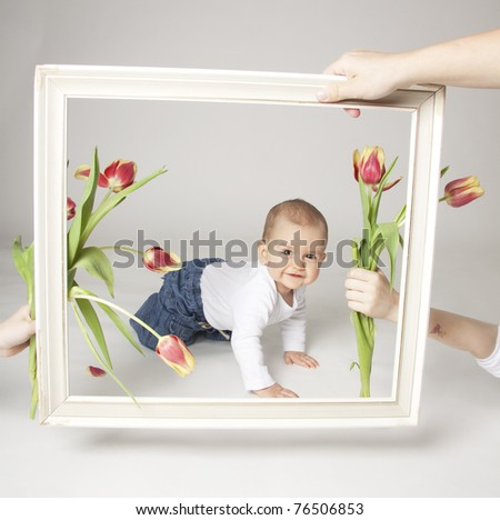 Baby boy with tulips in the  frame