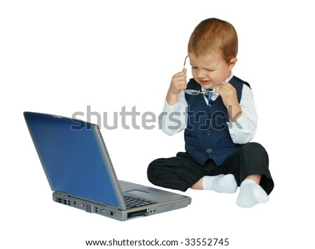 Baby businessman does not like what he sees on the computer or is tired after a long day at work