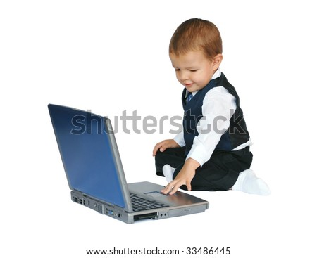 Baby businessman working on a laptop computer stock photo