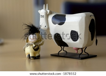 baby calf and cow in corporate environment