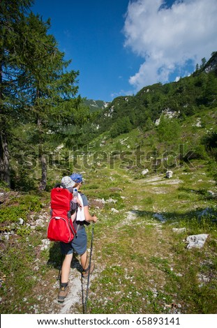 baby carrier in alps, on sunny day, julijan alps, slovenia