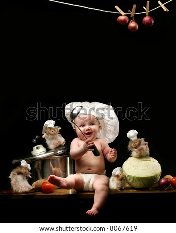 baby chef - little girl in the cook hat and hamsters