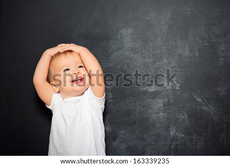 baby child and an empty Blackboard