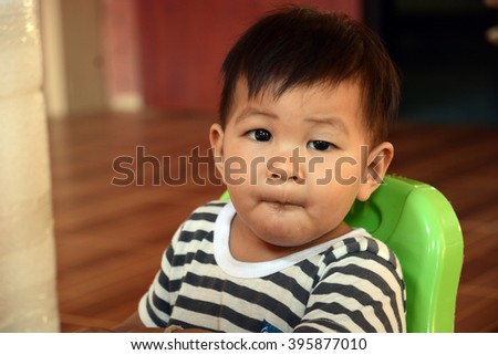 baby child eating in chair, thai baby #395877010
