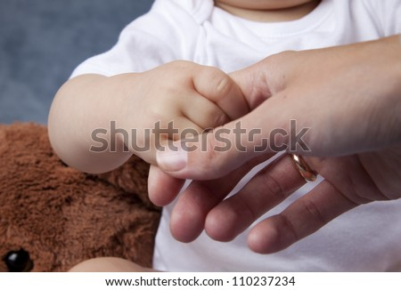 Baby child holding the handle