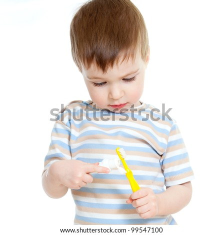 baby cleaning teeth, isolated on white background