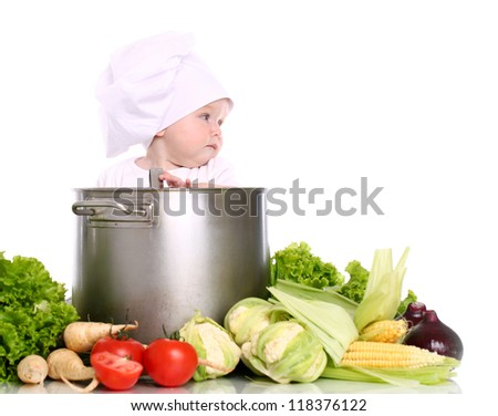 Baby cook with pan and vegetables isolated on a white