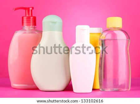Baby cosmetics on pink background