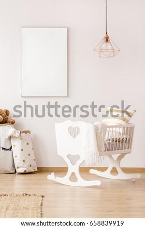 Baby cradle and mockup poster frame in scandinavian interior