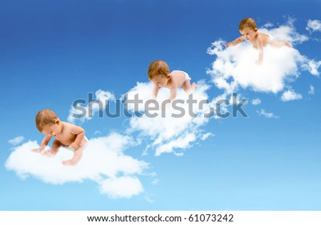 Baby crawling amongst the clouds