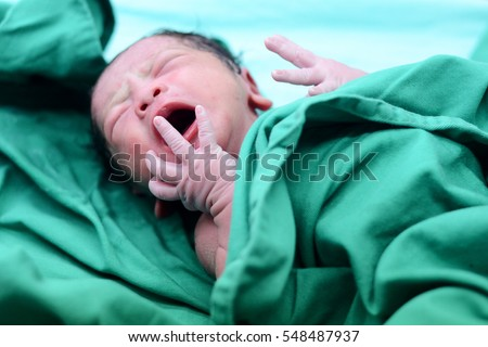 Baby crying after birth in labor room
