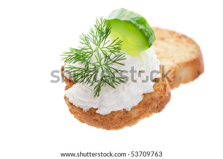 Baby cucumber and goat cheese; garnished with fresh dill.