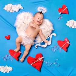 Baby cupid with angel wings, bow and arrows, textile decoration