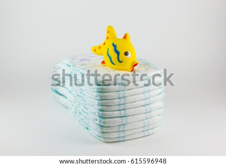 Baby diapers on a white background #615596948