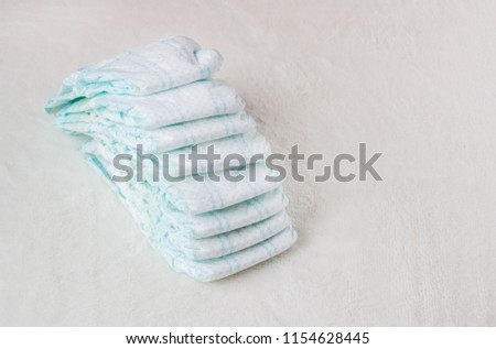 Baby diapers on a white background, diapers for babies #1154628445