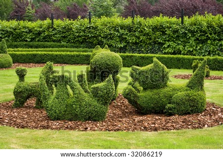 Baby dogs playing from structured Topiary park Durbui, Belgium