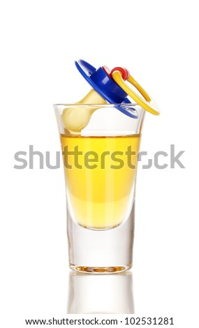 Baby dummy with alcoholic beverage isolated on white