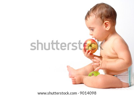 Baby eating a apple on white background . - stock photo
