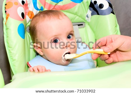 baby eating cottage cheese - stock photo