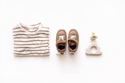 Baby fashion flay lay with matching colours isolated on white top view. Infant accessories