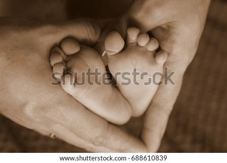 Baby feet #688610839