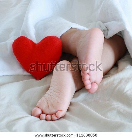 baby feet and red heart