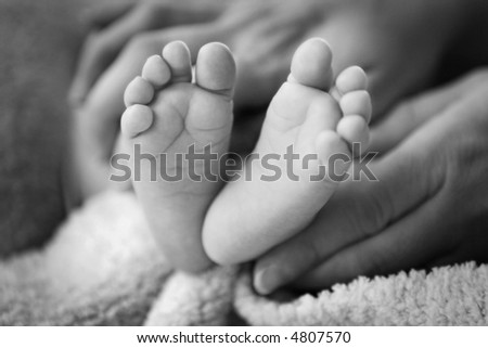 Baby Feet from 1-month-old baby, in Mother's Hands.  Shallow depth-of-field.