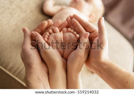 Baby feet in parent hands