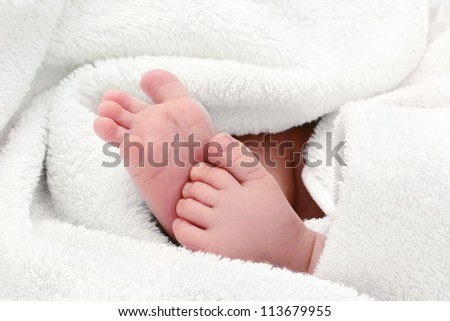 baby feet in white bath towel
