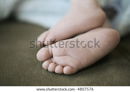 Baby Feet of 1-month-old baby.  Shallow depth-of-field.  Antique-style post processing.