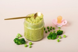 Baby food: organic green broccoli and spinach puree with ingredients. children food. mashed broccoli and peas