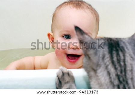 baby girl and cat