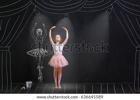 Baby girl dreaming a dancing ballet on the stage. Childhood concept. #636645589