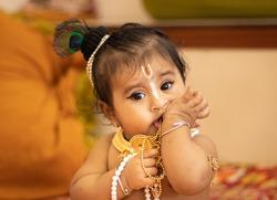 Baby girl dressed up like lord krishna/gopal on the occasion of janmashtami.