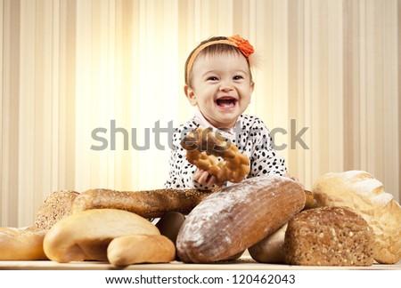 baby girl eating bread