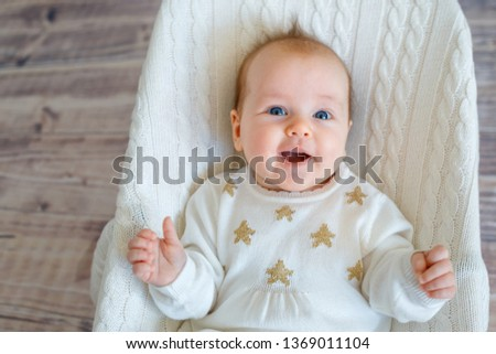 Baby girl having fun in bouncer indoors. Activities for infants