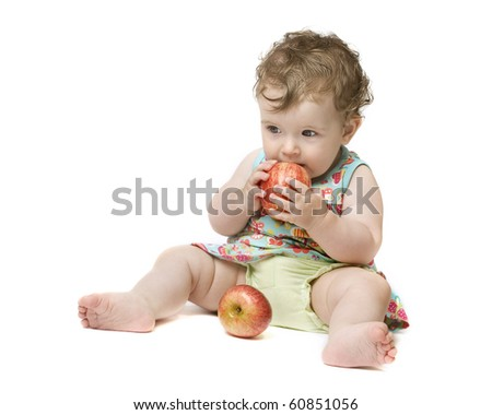 Baby girl holding big red apple. Isolated on white