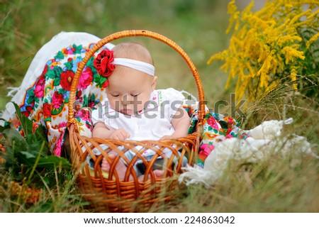 baby girl in a basket in the Ukrainian style.