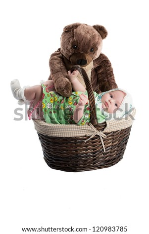 baby girl in a basket with toy bear isolated on white background .The concept of childhood and holiday